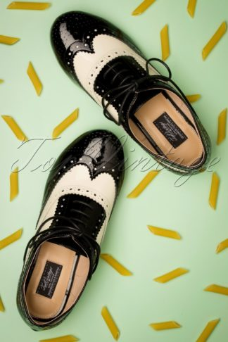 60s Penny Goes To Italy Brogue Flats in Black and Off White