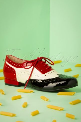 60s Penny Goes To Italy Brogue Flats in Black and Red
